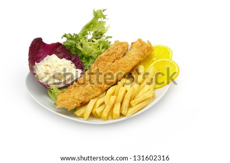 Gourmet fish and chips served with side salad. - stock photo