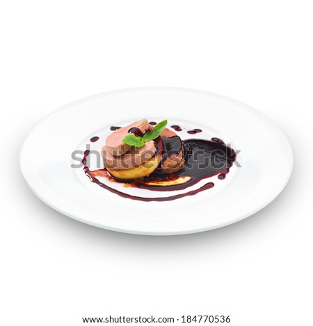 Gourmet foie gras served with red berry sauce and decorated with basil leaf. Isolated on white. - stock photo