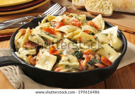Gourmet lobster ricotta cheese ravioli served in a cast iron skillet - stock photo