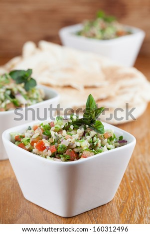 Gourmet Middle Eastern salad Tabbouleh in white bowls - stock photo