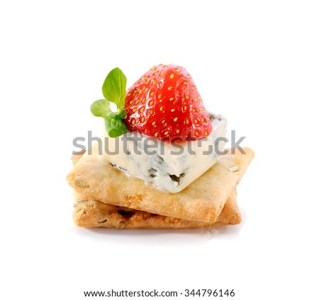 gourmet snack on crackers with  Dor Blue cheese and strawberry close-up isolated on white background  - stock photo