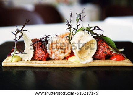 gourmet squid plate close up with beautiful garnish