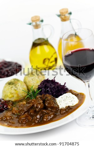 Gourmet Venison goulash with potato dumplings and garnish - stock photo
