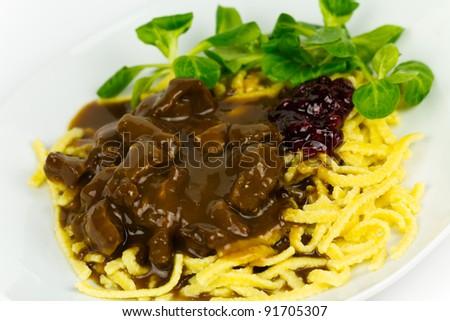 Gourmet Venison goulash with potato dumplings and garnish ,corn salad - stock photo
