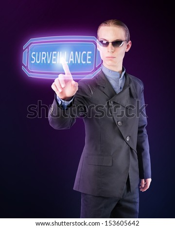 Government agent performing mass surveillance of citizens. - stock photo