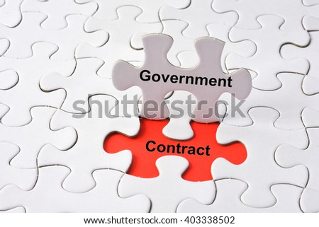 Government contract concept on missing puzzle - stock photo