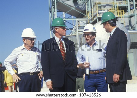 Governor Bill Clinton and Senator Al Gore meet with workers at an electric station on the 1992 Buscapade campaign tour in Waco, Texas - stock photo