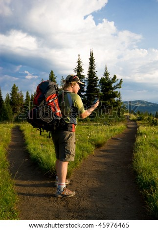 GPS at a fork in the trail - stock photo