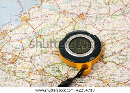 GPS Backtracker on a road map - stock photo