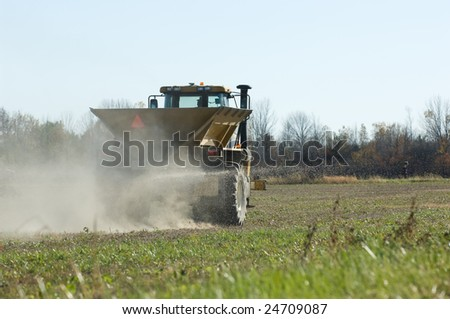 GPS controlled Winter Wheat fertilizer spreader. - stock photo
