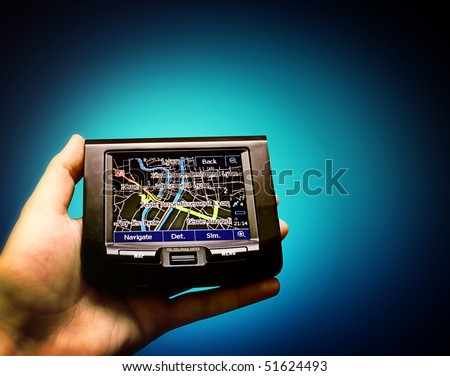 Gps in a man hand. Find your way ! - stock photo