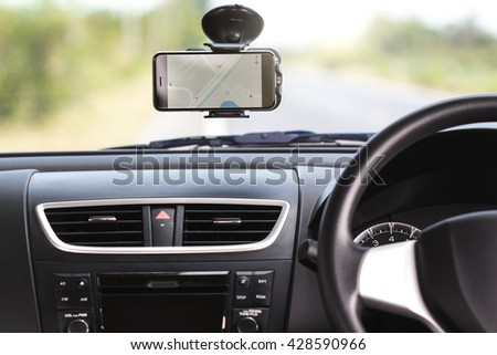 gps navigation map on phone in traveling car - stock photo