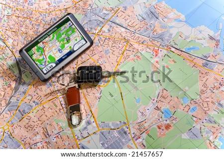 GPS Navigation system on a traveling map - stock photo