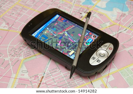 GPS navigator on a topographical map background - stock photo