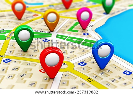 GPS satellite navigation, travel, tourism and location route planning business concept: macro view of color city map with group of colorful destination pointer marker icons with selective focus effect - stock photo