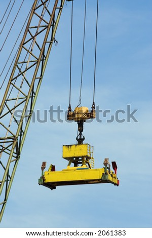 Grab of a large crane, ready to pick up containers at Antwerp harbor - stock photo