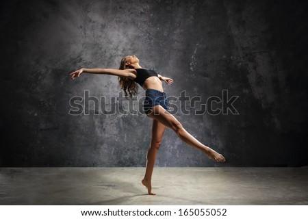 Graceful dancer/Beautiful young dancer in a sensual pose - stock photo
