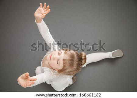 Graceful little ballerina, grey background