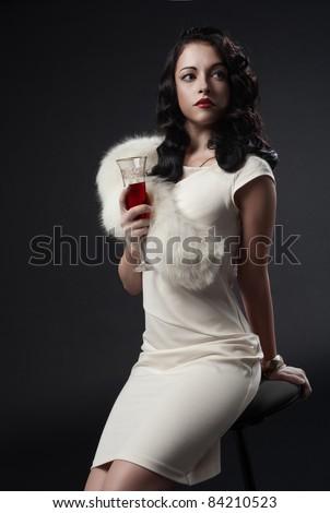 graceful woman holding glass of wine. retro portrait - stock photo