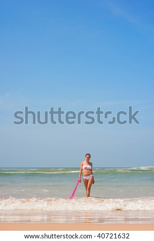 graceful woman in the ocean at the sunny day