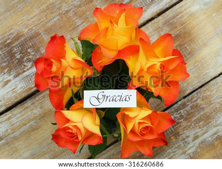 Gracias (which means thank you in Spanish) card with orange roses bouquet