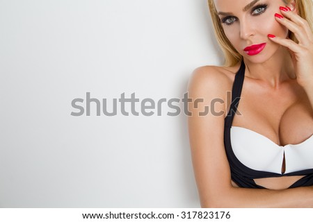 Gracious a young beautiful sexy woman with long blond straight your hair stands with long slender legs sensually in Bathed of shorts pajamas clothes dress smiling beautifully and sensually - stock photo