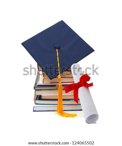 Grad hat and diploma with books isolated on white - stock photo