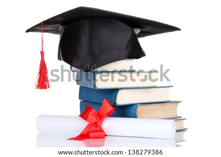 Grad hat with diploma and books isolated on white - stock photo