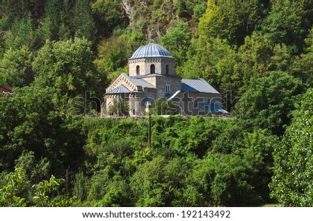 Gradac Monastery at the edge of the forested slopes Golija, Serbia - stock photo