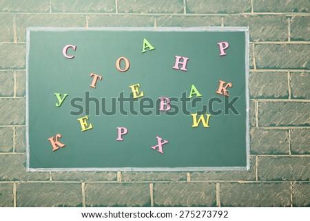 Grade school, letters on unusual blackboards - stock photo