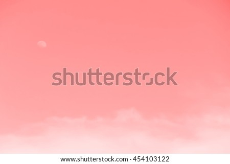 Gradient of red color, soft color gradient of fluffy cloud and half moon on a day light sky background, use for business presentation background or desktop wallpaper - stock photo