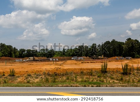Grading equipment at a construction site for new homes - stock photo