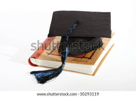 Graduate cap with book