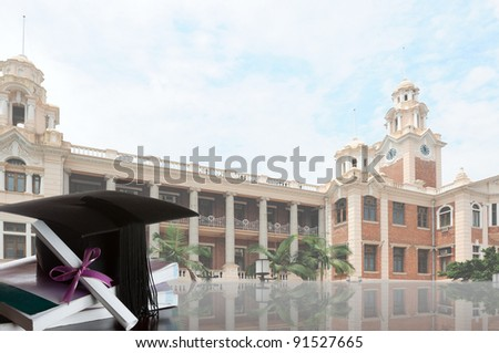 graduate certificate and graduate cap on a stack of books with university background - stock photo