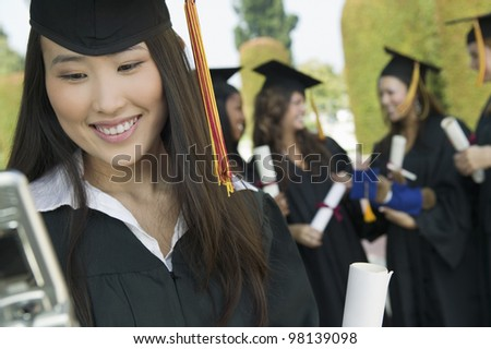 Graduate Checking Cell Phone