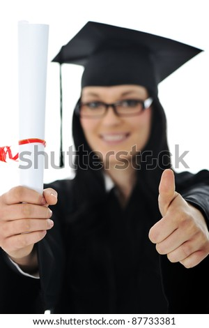 Graduate girl student in gown with diploma - stock photo