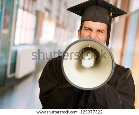 Graduate Man Shouting Into The Megaphone In University - stock photo