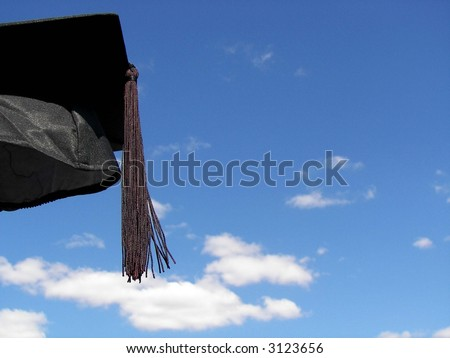 Graduate's hat airborne - stock photo
