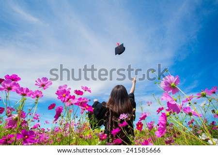 Graduate students Congratulate By throwing hats - stock photo