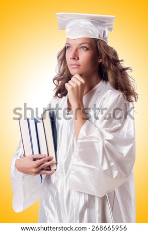 Graduate with book isolated on white - stock photo