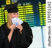 graduate woman holding euro notes at the airport - stock photo