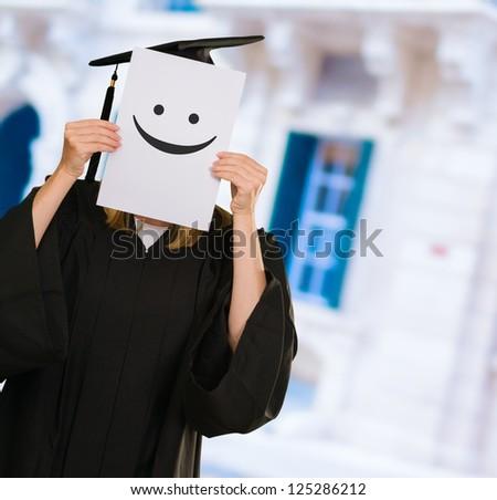 Graduate Woman Holding Placard, Indoors - stock photo
