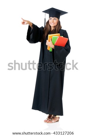 Graduate young woman student in mantle show something, isolated on white background