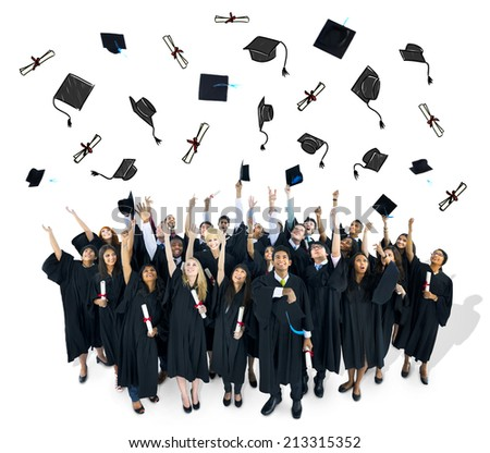 Graduates throwing their graducation caps.