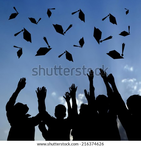 Graduating Students Throwing Caps In The Air  - stock photo