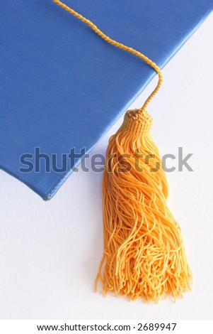Graduation blue cap on white background - stock photo