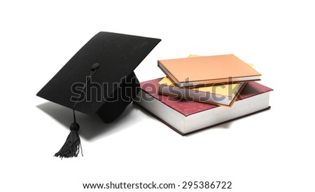 graduation cap and book isolated on white background - stock photo