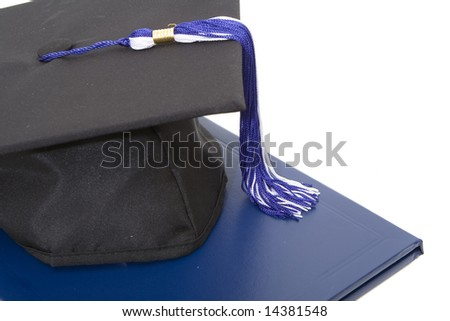 graduation cap and diploma isolated against white background - stock photo