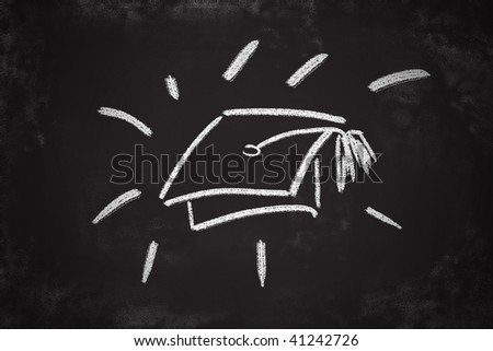 Graduation cap chalk drawing on classroom blackboard.