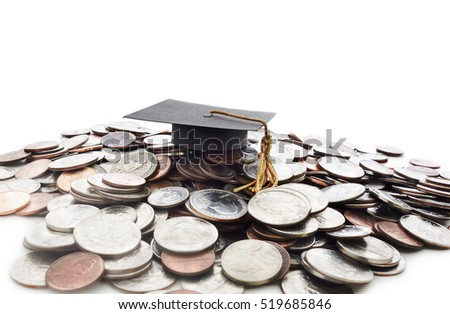 Graduation cap on a pile of money -- student loan concept